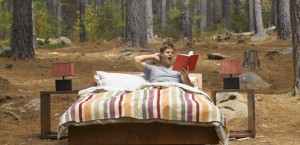 Mandatory Credit: Photo by OJO Images / Rex Features ( 828212a ) MODEL RELEASED A man reading in a bed outdoors in the woods VARIOUS /REX_OJO_STUFF218_828212a//0903191905